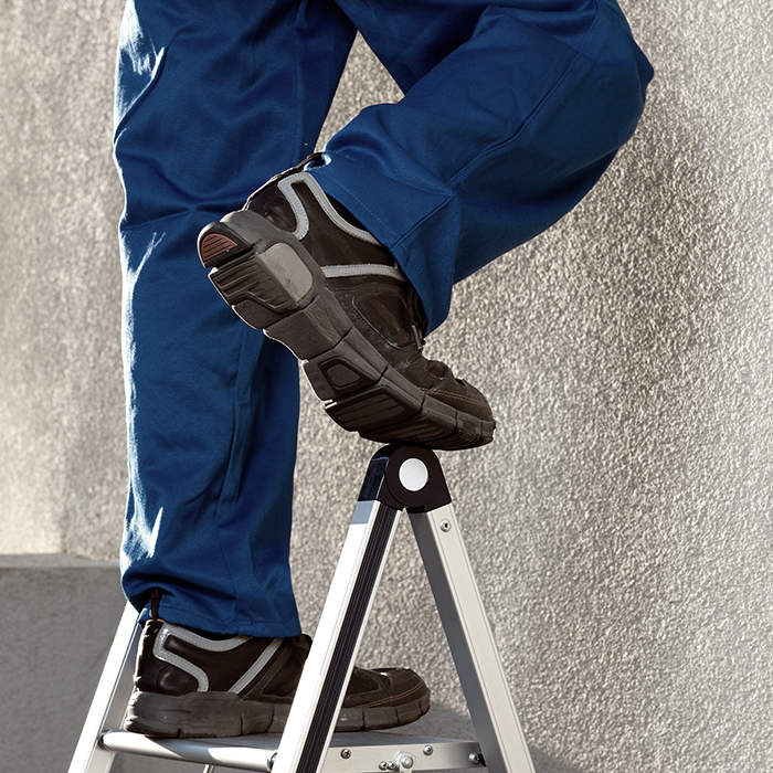 Photo of a worker on a ladder - construction liability insurance