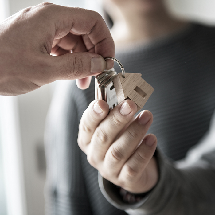 Photo of keys exchanging - property owners insurance